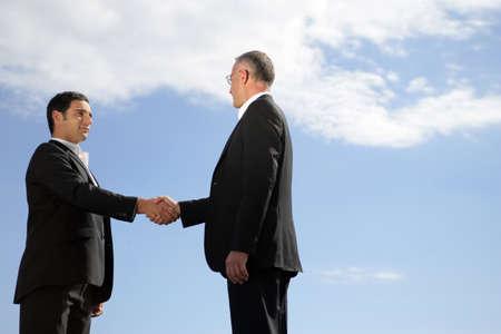 compromise: Men shaking hands Stock Photo