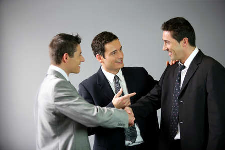 talking businessman: Three businessmen laughing Stock Photo