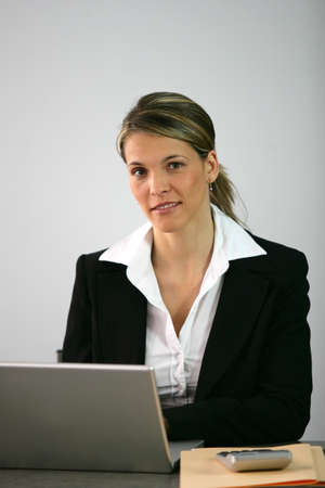 Blond accountant sat at desk Stock Photo - 13828082