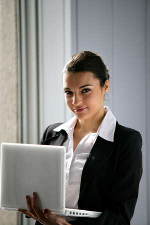 businesswoman holding a laptop photo
