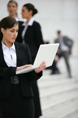 Businesswoman with a laptop in the city photo