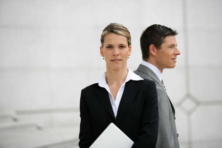 businessman and businesswoman back to back photo