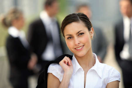 Businesswoman stood in front of colleagues outside Stock Photo - 13828111