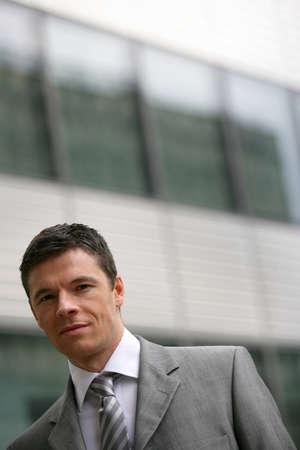 officetower: Businessman walking past office