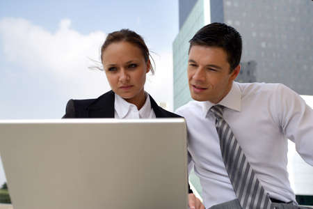 Businesspeople working on a project together outside photo