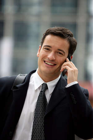 Businessman with briefcase making a call between appointments Stock Photo - 13828112