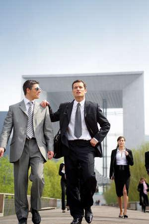 Businesspeople walking outdoors photo