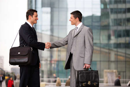 handshaking: Businessmen handshaking outdoors