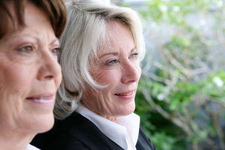 aging brain: Friends enjoying the view in a garden