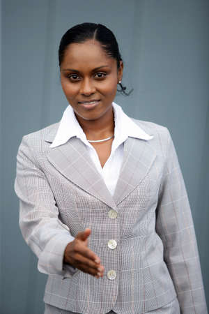 Businesswoman holding her hand out for a handshake Stock Photo - 13828292