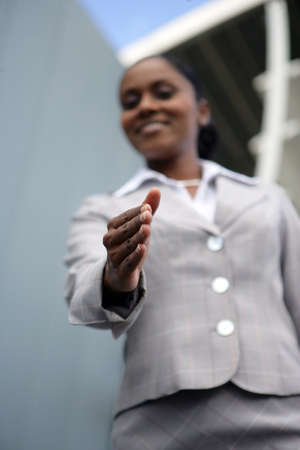 Businesswoman offering you her hand photo