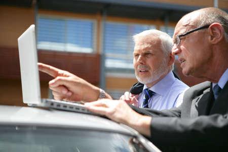 Senior businessteam visiting clinet Stock Photo - 13828225