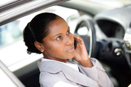Businesswoman making a call whilst in parked car Stock Photo - 13828236