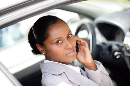 Woman in a car using a cellphone photo