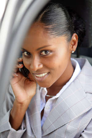 Businesswoman making a call from her car photo