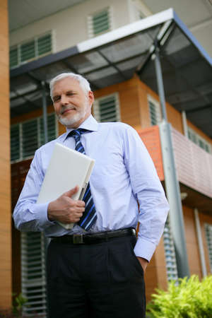officetower: Grey-haired business on his way to client Stock Photo