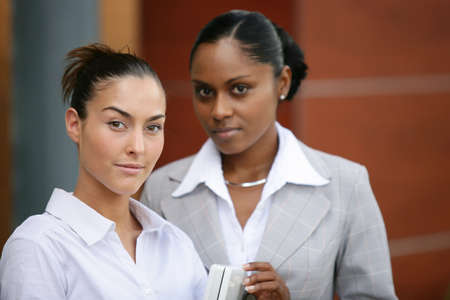 gorgeous businesswoman: Two businesswomen stood outside office