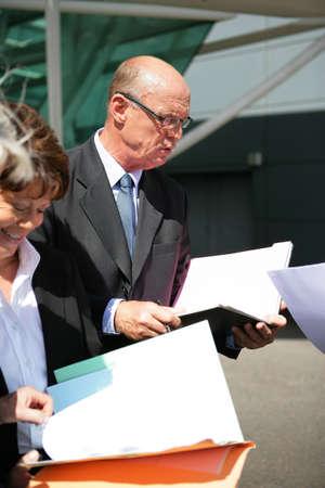 senior businessman and businesswoman reading documents Stock Photo - 13827906