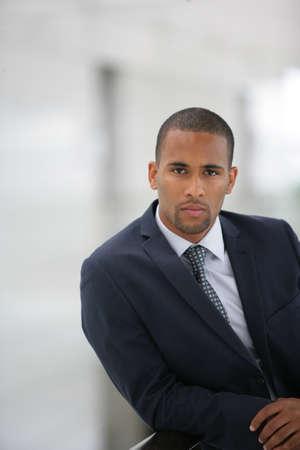 man s: Confident businessman leaning