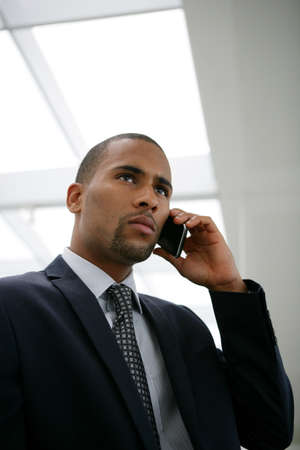 African businessman calling his boss Stock Photo - 13827972