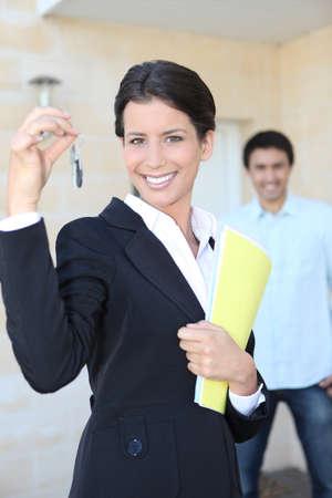 Estate agent with doorkeys Stock Photo - 13827984