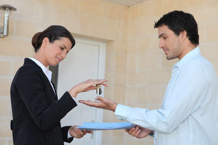 New property owner receiving the keys to his property Stock fotó