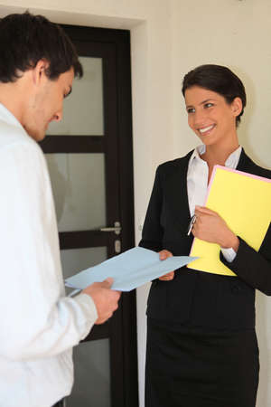 Smart woman giving contract to a man photo