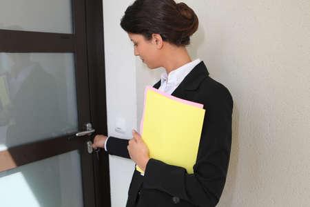homebuyer: Estate agent opening a door
