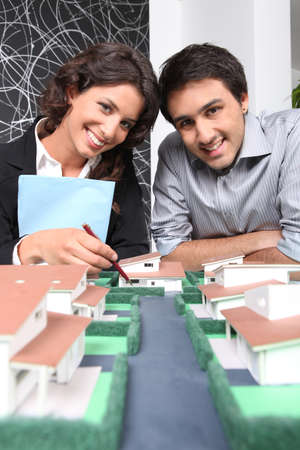 housing lot: Architects posing with their building model