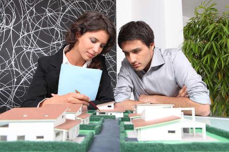 examining: Architects examining a model Stock Photo