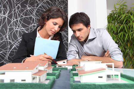 zoning: Architects examining a model Stock Photo