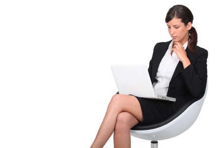crusades: Woman sitting in armchair with computer
