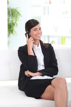 skirt suit: Woman on the phone