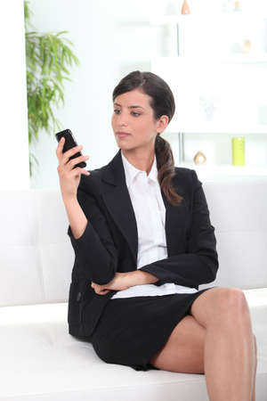 preppy: young businesswoman reading sms