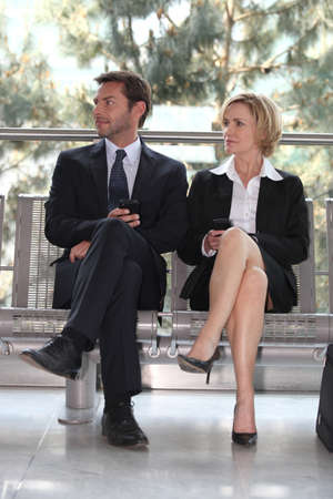 sitting area: Businesspeople in a waiting room Stock Photo