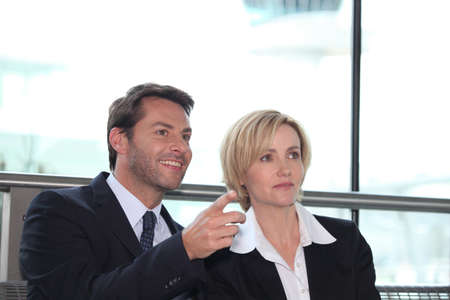 Businesswoman and man pointing photo