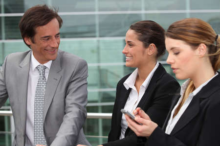Three business people stood outside workplace Stock Photo - 13845714