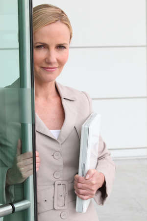 Woman opening door to a collaborator Stock Photo - 13846081
