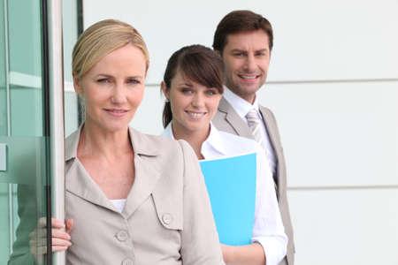 collaborators: business team by a door