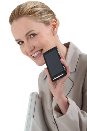 Smiling woman with a mobile phone photo