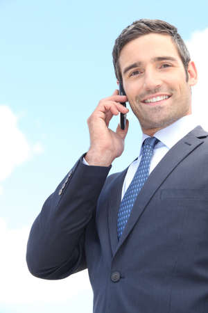Businessman using a cellphone Stock Photo - 13845833