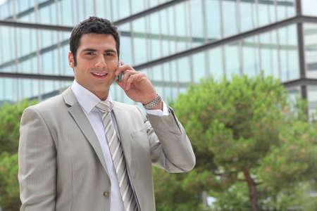 businessman waiting call: Banker having phone call outdoors Stock Photo