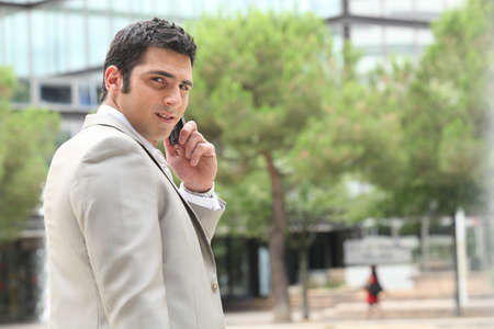 calling on phone: Businessman on mobile phone