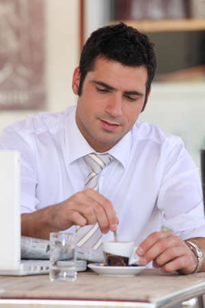 Businessman having an expresso in a cafe photo