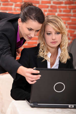 Young women working at a laptop photo