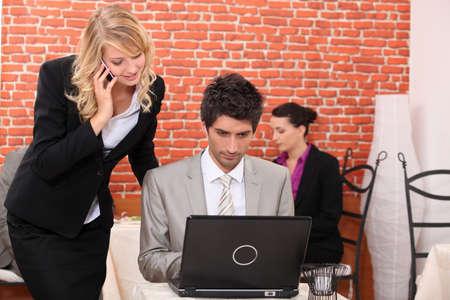 Man and woman looking at a laptop computer photo