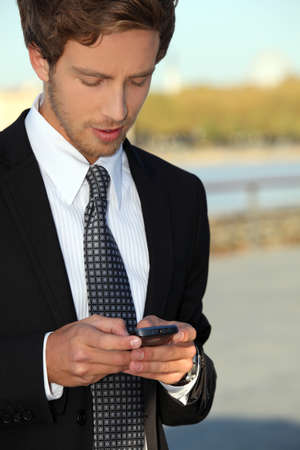 Young man using smartphone photo