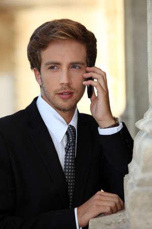 telephone salesman: Young businessman on phone