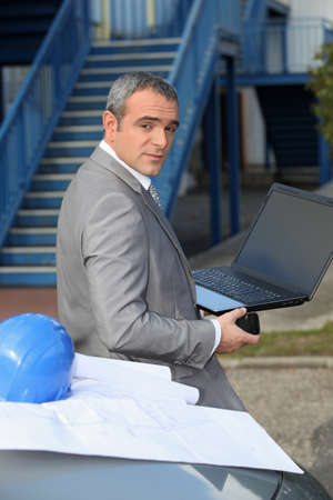 Architect with a laptop computer Stock Photo - 13841920