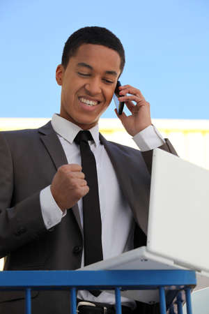 listen fist: Delighted businessman on the phone